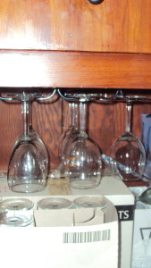 using the buffet built ins for the modern age, wine glass storage on top and more glasses in boxes.